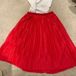 Pleated red knee length skirt H&M small